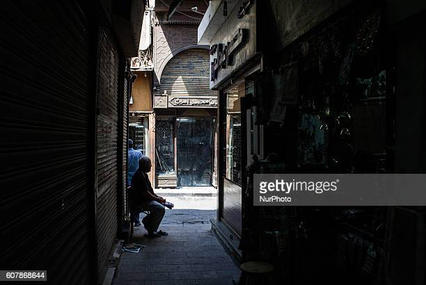 An Egyptian vendor waits for customers in his shop in Khan AlKhalili market in Cairo Egypton September 19 2016 Shops are not working because of the...