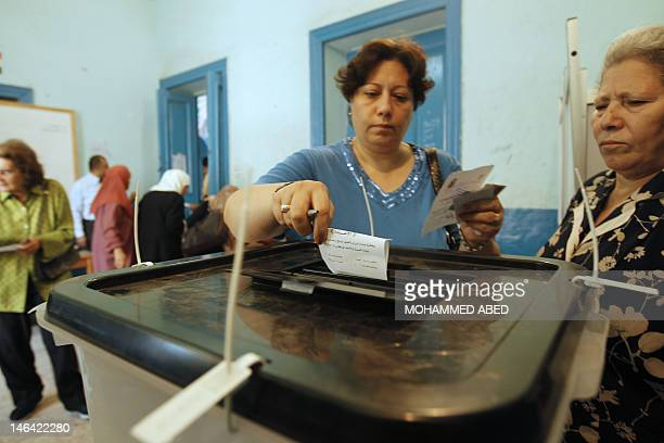 An Egyptian woman casts her vote at a polling in Cairo on June 16 2012 in a divisive presidential runoff pitting ousted strongman Hosni Mubarak's...