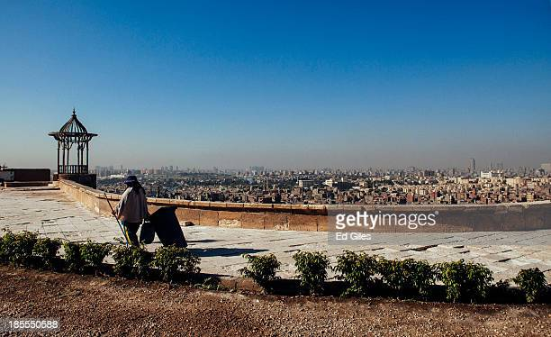 An Egyptian woman cleans up the grounds of the Muhammad Ali Mosque in Cairo's Citadel on October 21 2013 in Cairo Egypt The Muhammad Ali Mosque...