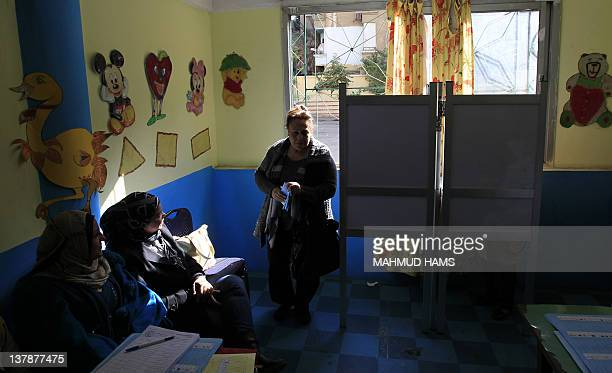 An Egyptian woman comes out of a voting booth at a polling station in Cairo's Zamalek neighbourhood on January 29 2012 during the first stage of...