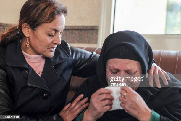 An Egyptian woman comforts an elderly Coptic Christian lady who weeps upon arriving to take refuge at the Evangelical Church in the Suez Canal city...
