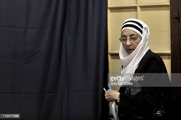 An Egyptian woman exits a voting booth in Cairo on March 19 2011 as Egyptians got their first taste of democracy in a referendum to a package of...