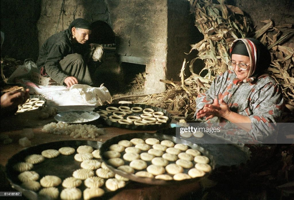 An Egyptian woman prepares 17 January traditional cookies for the three-day Eid al-Fitr festival in the village of Tanta, north of Cairo. Eid will start 19 January after the last day of the Moslem fasting month of Ramadan.