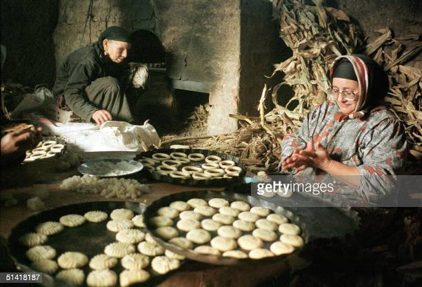 An Egyptian woman prepares 17 January traditional cookies for the threeday Eid alFitr festival in the village of Tanta north of Cairo Eid will start...