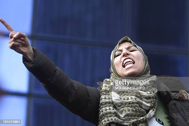An Egyptian woman shouts as she demonstrates outside the Lawyers' Sydicate in Cairo on January 27 demanding the ouster of President Hosni Mubarak...