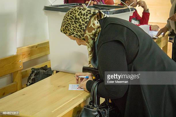 An Egyptian woman visits a polling station in downtown Cairo, to cast her vote in the Egyptian constitutional referendum, held on the 14th and 15th...