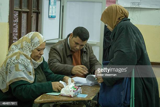 An Egyptian woman visits a polling station to cast her vote in the Egyptian constitutional referendum, held on the 14th and 15th of January 2014.