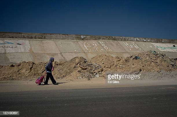 An Egyptian woman walks down a street in the city of El Arish the capital of Egypt's restive North Sinai region September 20 2012 The area is at the...