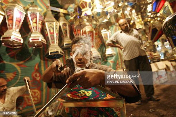 An Egyptian youth crafts 'Fanous Ramadan' a traditional candle lamp for the holy fasting month of Ramadan at a shop in downtown Cairo late 10...
