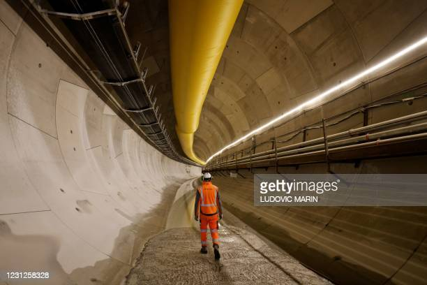 """An Eiffage employee walks in the tunnel digged by the """"Camille"""" boring machine on the construction site of the line 15, a new line part of the Grand..."""