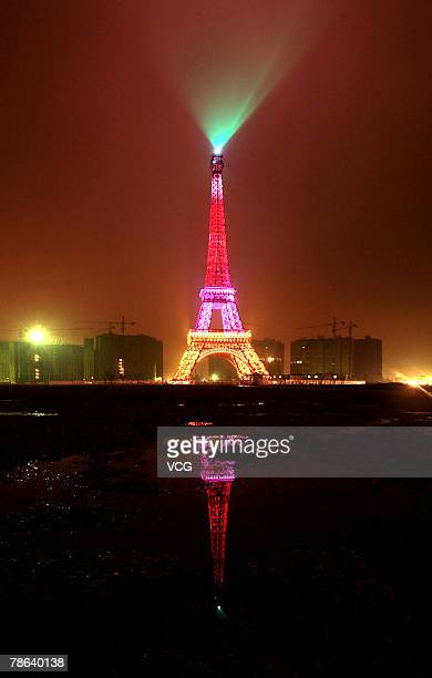 An 'Eiffel Tower' style structure is lighted for the holidays on December 22 2007 in Hangzhou Zhejiang Province China According to the workers it is...