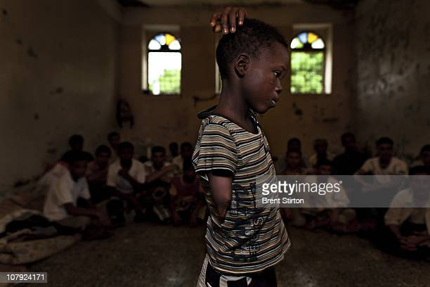 An eight year old amputee Nigerian boy locked up in Hodeidah Central Prison Hodeidah Yemen August 12 2010 He is in prison with a man who claims to be...