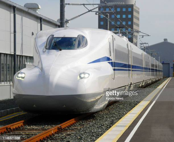 An eightcar N700S Tokaido shinkansen bullet train is unveiled to the press during a test run at Central Japan Railway Co's Hamamatsu factory in...