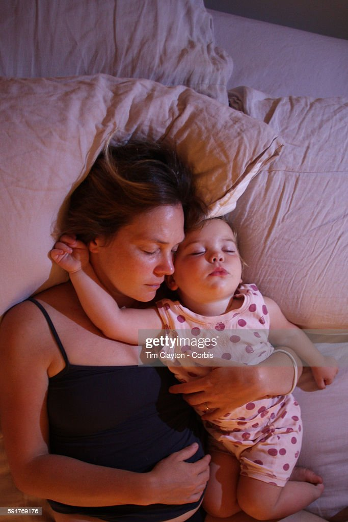 Mother and Baby Sleeping : News Photo