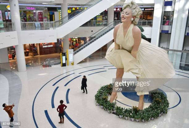 An eightmetertall sculpture of American actress and model Marilyn Monroe is exhibited at a shopping mall on November 14 2017 in Dalian Liaoning...
