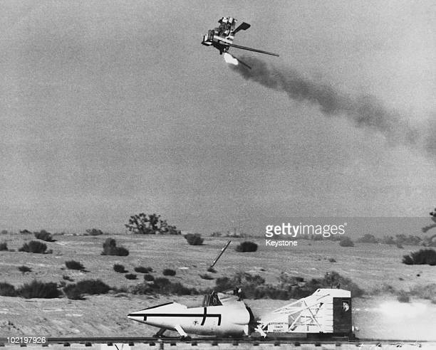 An ejector seat is tested using a high speed rocket sled at Edwards Air Force Base California 1959 The seat is being developed for use on the North...