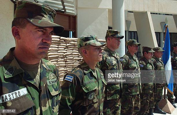 An El Salvadoran military unit stands at attention prior to a visit by Chief American Coalition Provisional Authority Administrator J. Paul Bremer...