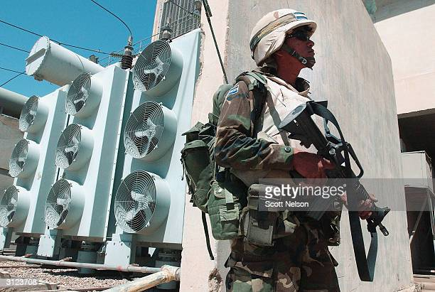An El Salvadoran soldier patrols the Najaf Power Plant March 23, 2004 in Najaf, Iraq. An El Salvadoran military unit recently fought off an small...