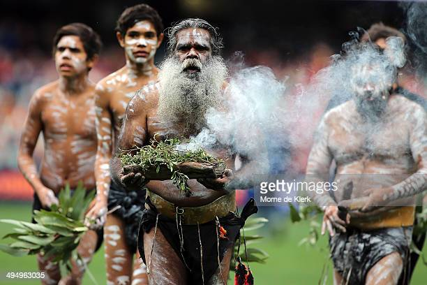 An elder performs the Welcome to Country ceremony during the round 11 AFL match between the Adelaide Crows and the Gold Coast Suns at Adelaide Oval...