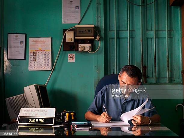 an elder public notary at his desk. - nameplate stock pictures, royalty-free photos & images
