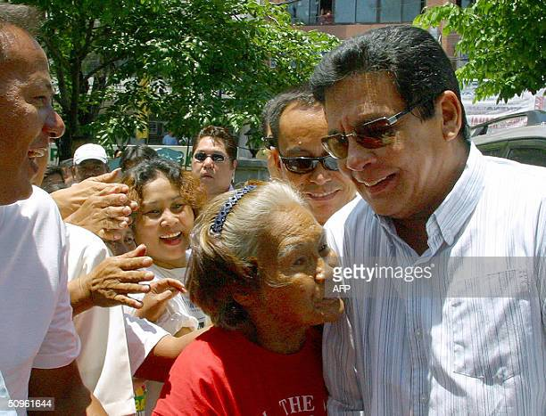 An elderly admirer of Philippine presidential candidate Fernando Poe Jr greets him during his visit to Malabon in suburban Manila 15 June 2004 Poe...