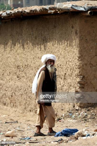 An elderly Afghan refugee is seen in a street during a visit of Anadolu Agency team at an refugee camp in a slum dwelling neighborhood on the...