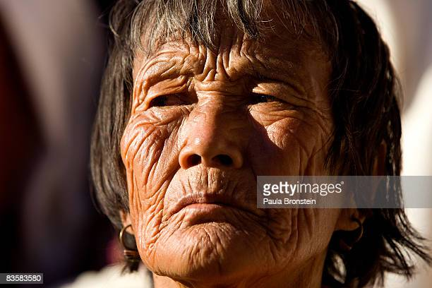 An elderly Bhutanese woman watches His Majesty Jigme Khesar Namgyel Wangchuck greeting his people at the ceremonial grounds of The Tendrey Thang on...