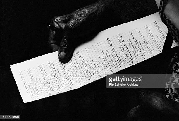An elderly black woman holds a sample voting ballot during a class for newly registered voters in Alabama Civil rights activists held the classes so...