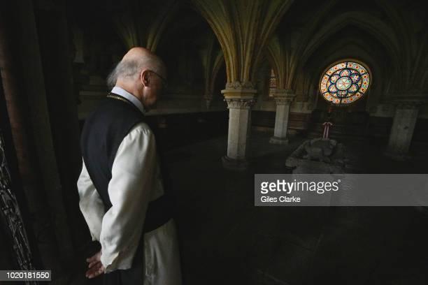 An elderly Cistercian monk looks at tomb of a former monk inside Heiligenkreuz Abbey. Heiligenkreuz Abbey is a Cistercian monastery in the village of...