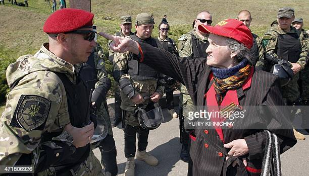An elderly Communist supporter argues with police officer at the WWII museum during a Communists rally marking May Day on May 1 2015 in Kiev On April...
