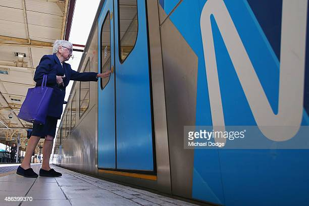 An elderly commuter at Flinders Street Station left stranded at an abandoned train shortly before Train Union workers start their strike on September...