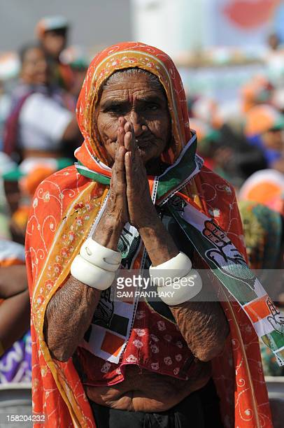 An elderly Congress supporter greets during a Congress rally addressed by general secretary Rahul Gandhi ahead of the Gujarat Assembly polls at...