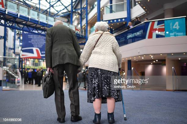 An elderly couple arrive at the Conservative Party Conference on October 3, 2018 in Birmingham, England.