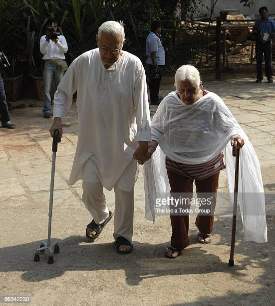 An elderly couple heads toward a polling booth to cast their votes during the third phase of polling on April 30 2009 in Mumbai India India is the...