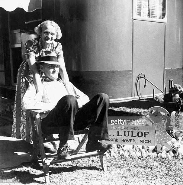 An elderly couple sit before the mobile home of Mr and Mrs Lulof in Sarasota Florida January 1941