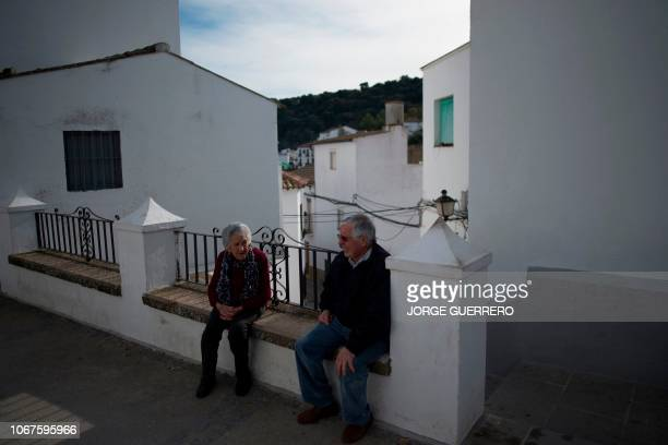An elderly couple sit in Setenil de las Bodegas near Cadiz on December 2, 2018 during Andalusia's regional election.