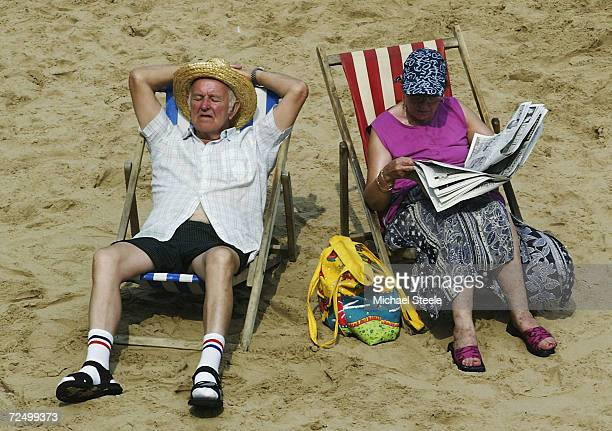 An elderly couple soak up the sun on Blackpool beach August 6 2003 in Blackpool England The temperature in the UK peaked at 359 degrees Celsius today...