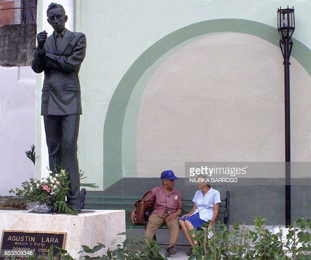 'AUGUSTIN LARA IS REMEMBERED IN HAVANA' BY GERARDO TENA An elderly couple talks next to the statue of Mexican musicianpoet Agustin Lara in the...