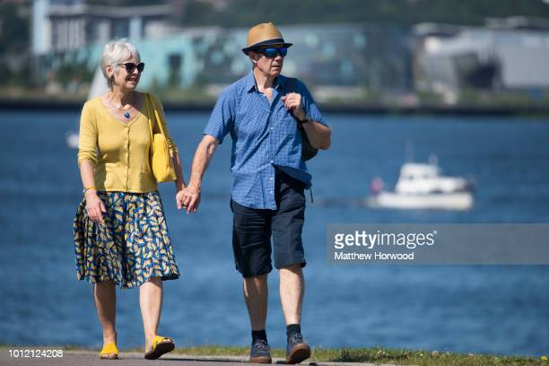 An elderly couple walk in Cardiff Bay on June 6 2017 in Cardiff United Kingdom