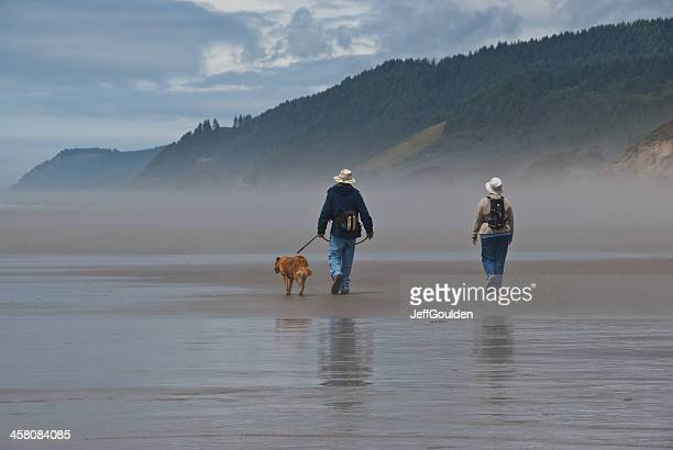 Elderly Couple Walking a Dog