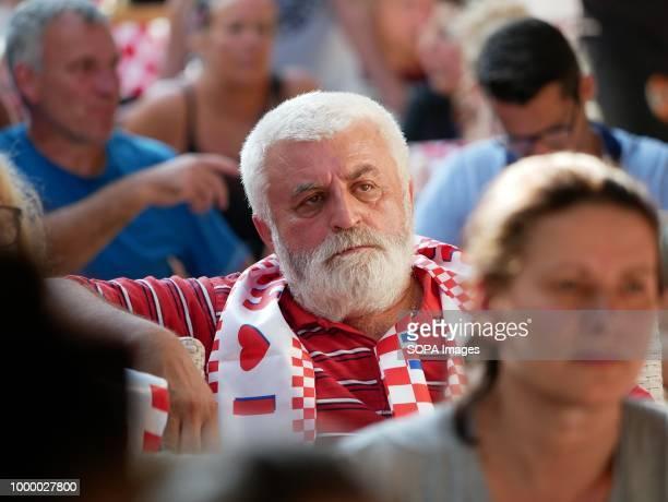 An elderly Croatian man is seen in sorrow Croatians in the Island of Pag watched the world cup football final match Croatia vs France Croatia lost 24...