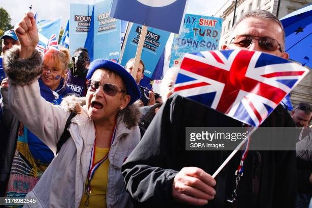 An elderly demonstrator shouts slogans along Piccadilly during the protest A mass 'Together for the Final Say' march organised by the 'People's Vote'...