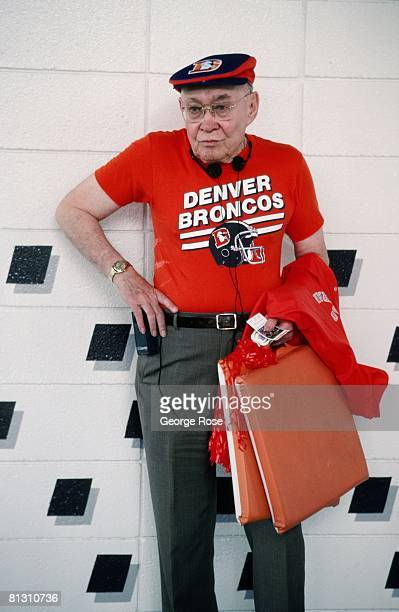 An elderly Denver Bronco football fan is decked out in the latest team clothing during a 1987 Denver Colorado football game at Mile High Stadium