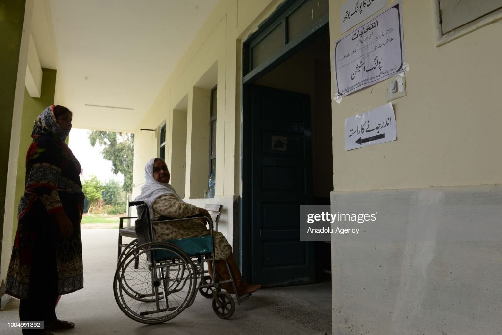 An elderly disable female Pakistani voter waits for her turn to cast her ballot at a polling station in Rawalpindi Pakistan on July 25 2018 Millions..
