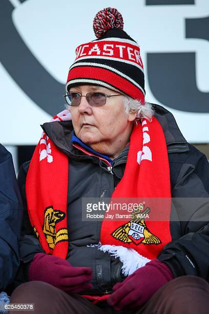 An elderly Doncaster Rovers fan wearing a bobble hat and scarf during the Sky Bet League Two match between Doncaster Rovers and Hartlepool United at...