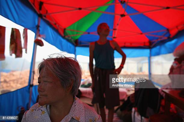 An elderly earthquake survivor couple rests inside a tent at a refugee camp on June 5, 2008 in Shifang, Sichuan province, China. More than 69,000...