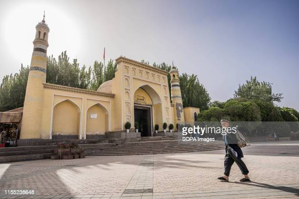 An elderly ethic Uyghur man walks in front of the Id Kah Mosque in Kashgar The Xinjiang province is located in the North Western part of China it is...