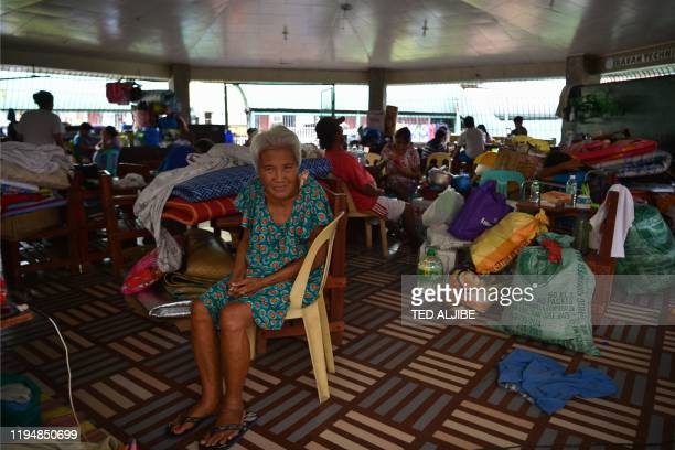 An elderly evacuee rests inside an evacuation centre in Bauan town Batangas province south of Manila on January 20 2020 Philippine authorities...