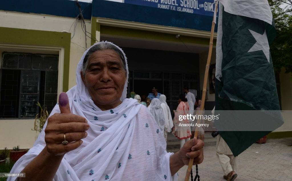 An elderly female Pakistani voter shows her thumb after casting her ballot at a polling station in Rawalpindi Pakistan on July 25 2018 Millions of...