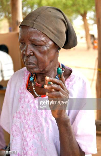 An elderly firsttime woman voter outside Terekeka southern Sudan holds up her inked finger designed to ensure that nobody voted twice during Sudan=s...